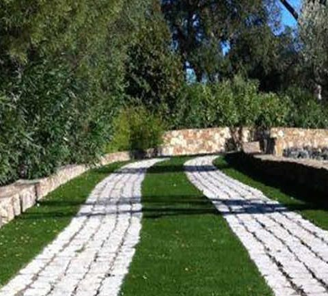 stone paths with fake grass in between