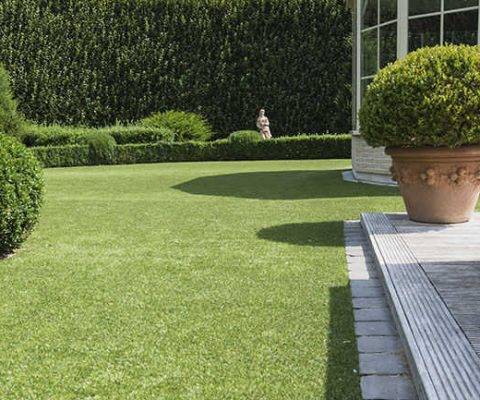 artificial grass next to summer house and wooden decking