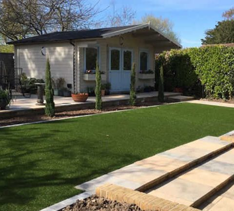 artificial grass infront of summer house