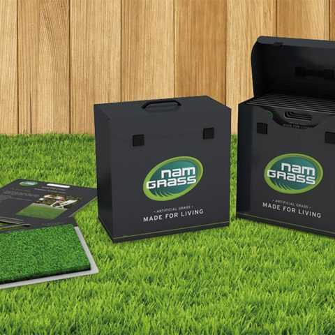 sample box of fake grass products