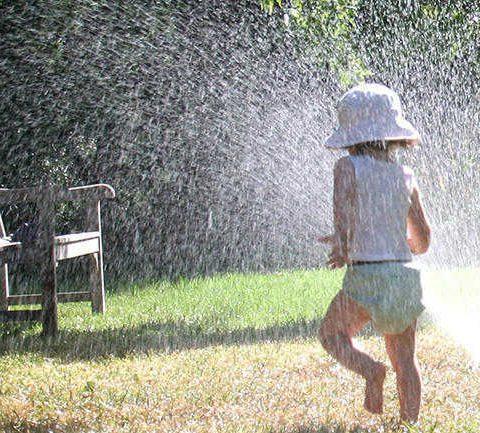child running in muddy wet lawn