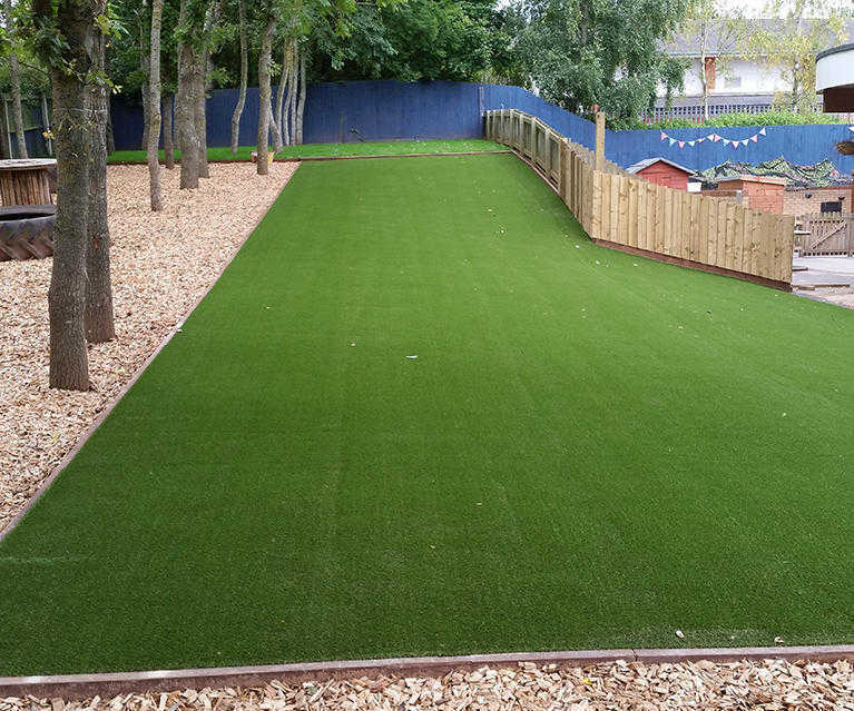 artificial grass laid in play area at school Nursery