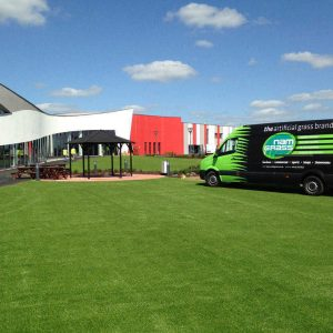 artificial grass laid outside large car show room