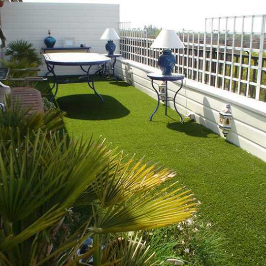 vibrant artificial grass on country style balcony