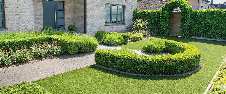 smart fake grass laid around hedge arch