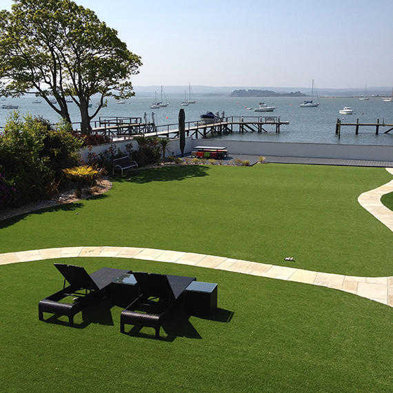 artificial grass laid in back garden with view of sea