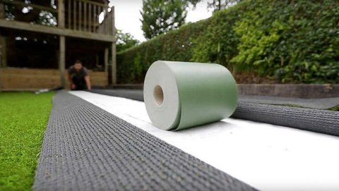 joint tape rolled out to join artificial grass