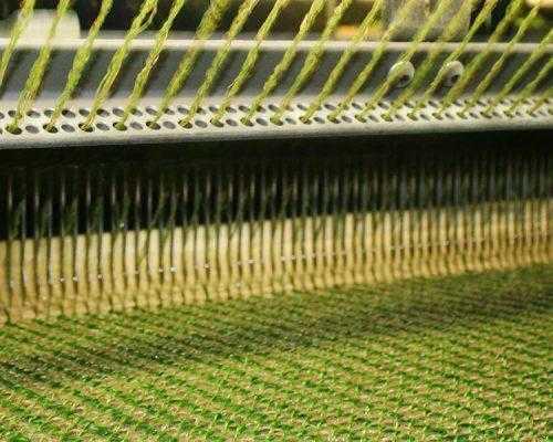 machine creating fake grass yarn