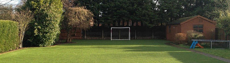 ligth greeen artificial grass in family garden