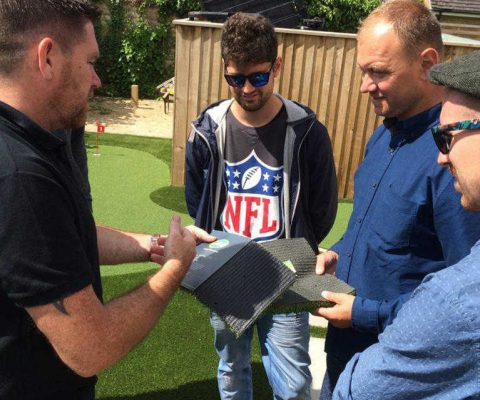 installers discussing over artificial grass samples
