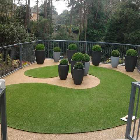 Genial Fake Grass Cut Into Design And Laid On Balcony