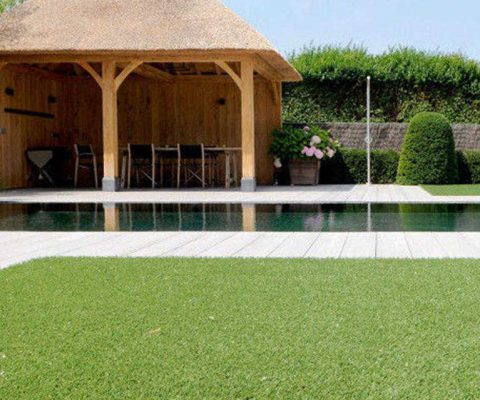 fake grass laid by pool and summer house