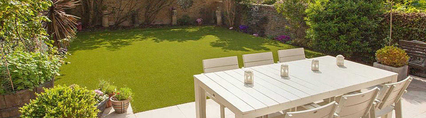 white dining table on fake grass
