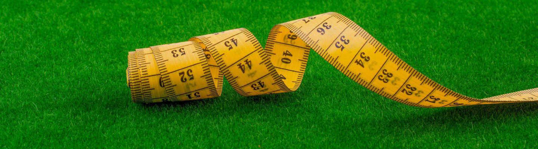 tape measure measuring artificial grass