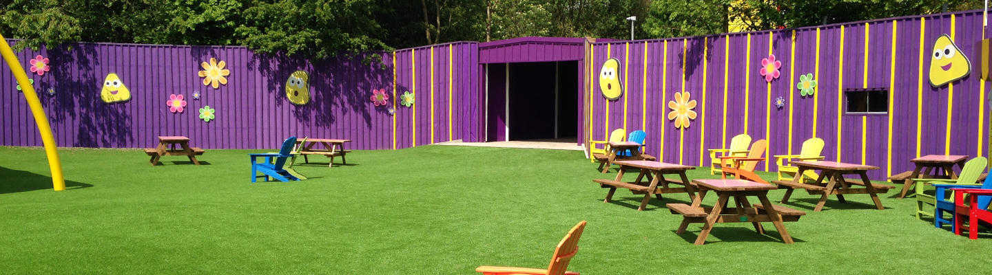 hard wearing fake grass laid for play area