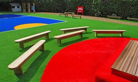 multi coloured artificial grass patterns in school nursery
