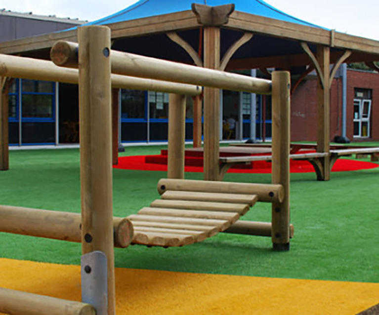 Coloured patterned artificial grass in school play ground