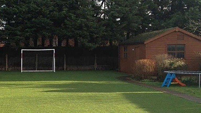 artificial grass laid in garden for children