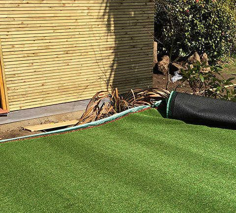 rolling out artificial grass