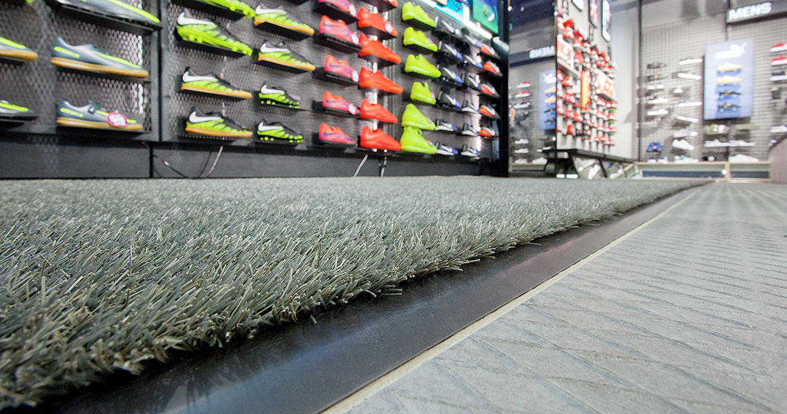 Football boots in display with artificial grass