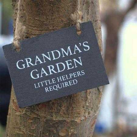 Grandmas garden sign hanging from a tree