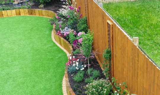 tidy artificial grass garden next to a messy natural lawn