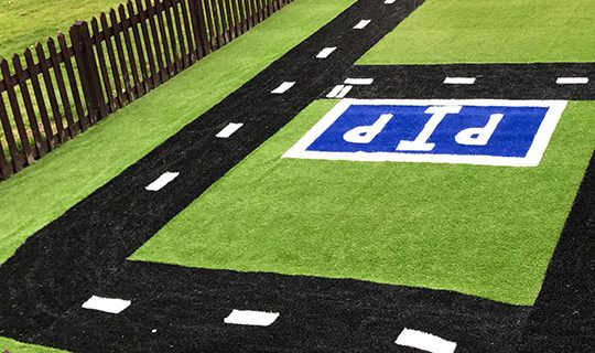 Road made with fake coloured turf