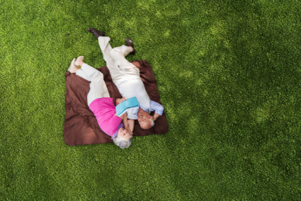 couple lay on grass